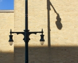lamp-post-and-shadow-on-brick-wall-Portland_DSC03129