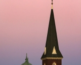 Saint Joseph Church and Kora Temple against pink sunset sky