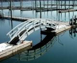 arched-footbridge-in-empty-marina_COS 167