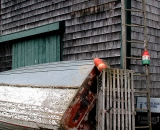 boat-and-lobster-trap-against-old-barn_COS 061