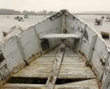 Old rowboat at sea shore