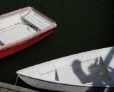 Red and white dinghies at dock