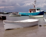 fishing-boat-and-skiffs-in-harbor-with-storm-clouds-at-Pine-Point_DSCN6550