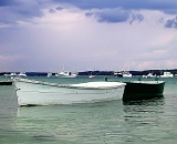 fishing-boat-and-skiffs-in-harbor-with-storm-clouds-at-Pine-Point_DSCN6560