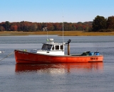 red-fishing-boat-with-reflection-at-Pine-Point_DSC01883