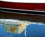 close-up-of-red-boat-reflections_12011