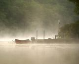 early-morning-mist-on-water-with-dockand-boat_DSC09804
