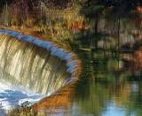 Water rushing over edge of dam