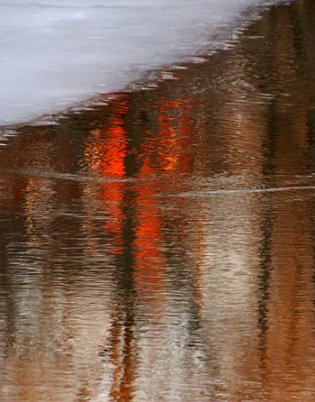 ice and light reflections on the androscoggin river