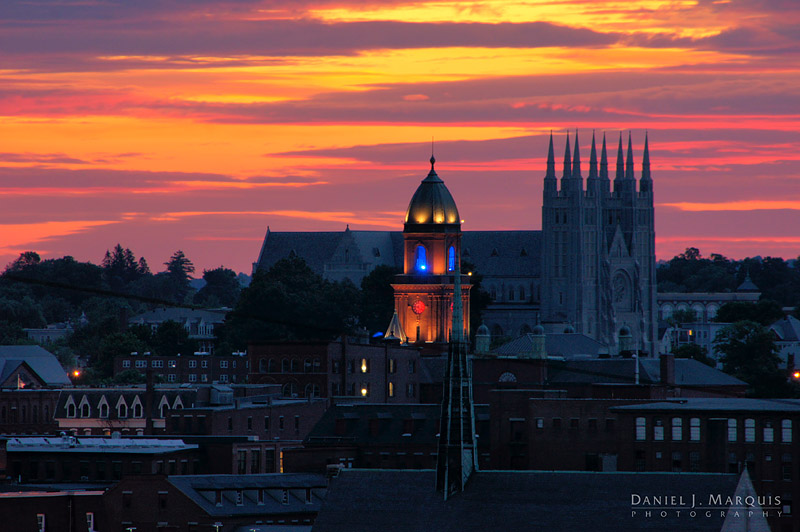 dawn breaks over Lewiston, Maine, with City Hall, Saints Peter and Paul Basilica and Franco Center