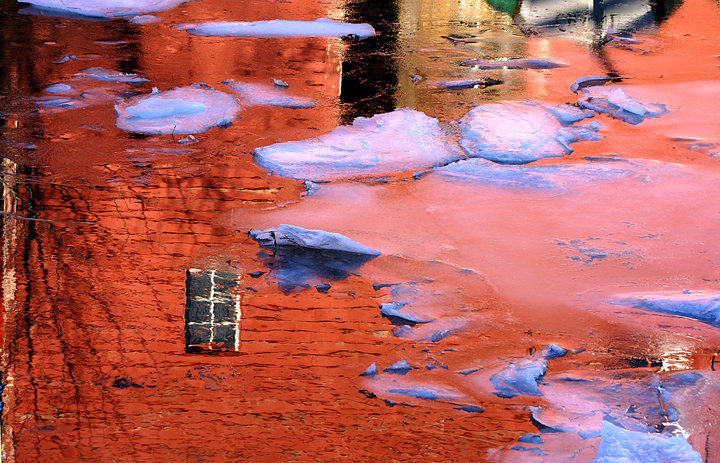 red-barn-reflected-in-icy-river