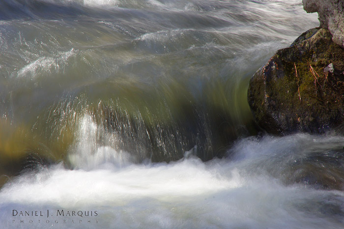 Water rushing over rocks in stream